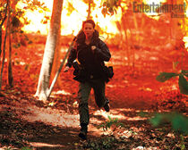 Katniss running away from the fire