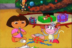 Dora and boots open christmas gifts