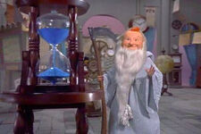 Father Time look at hourglass
