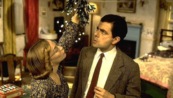 Mr Bean and Irma under the mistletoe