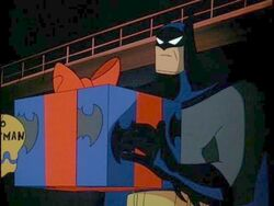 Batman holding a gift box