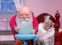 Santa reading Mrs. Claus' note