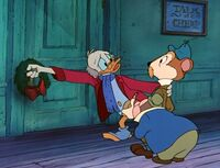 Scrooge turning down Ratty and Mole