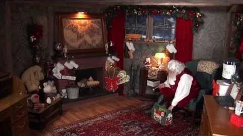 Santa Claus has a Christmas sign for you on the Santa Snooper!