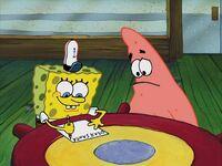 SpongeBob shows Patrick how to write
