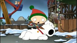 Stewie holds the gun at Brian