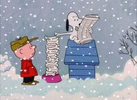 Snoopy reading the newspaper