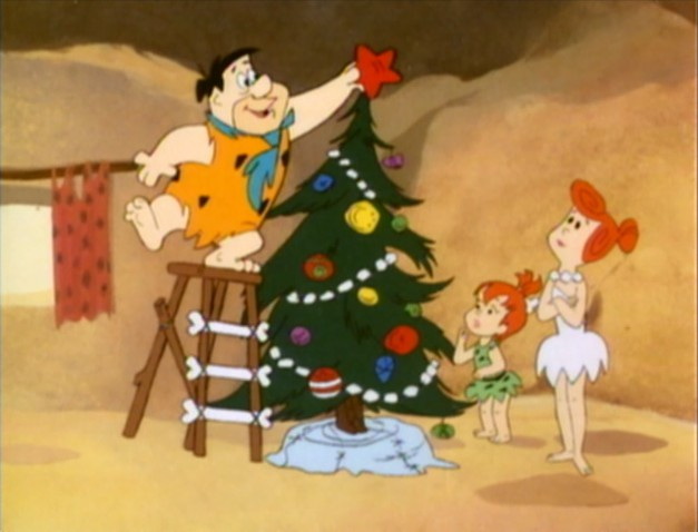 File:Fred putting the star on the tree.jpg