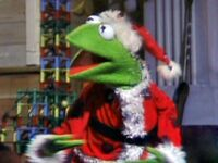 Kermit dressed as Santa