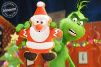 Grinch with Santa cookie