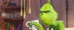 Grinch with coffee mug