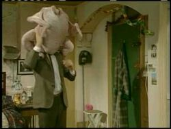 Mr Bean's Turkey on his head