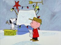 Snoopy decorating his doghouse