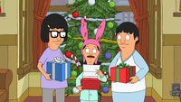 Tina, louise and gene holding presents