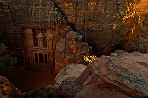 The Treasury (Al Khazneh) in Petra at sunset, viewed from the top of the Siq