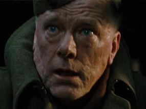 Stig Eldred as Army Commander-1-