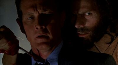 John Doggett is taken hostage by Robert Fassl