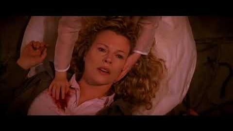 Kim Basinger gets resurrected from the dead after being shot twice