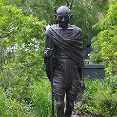 A statue of Gandhi with a walking stick (which appears to have inspired his in-game model)