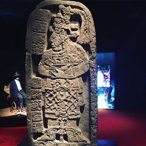 A stela depicting Lady Six Sky standing on the back of a prisoner of war (which appears to have inspired her in-game model)
