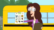 Ms. Baker holding up the Zoo worksheet