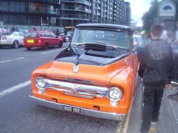 Orange and black pickup
