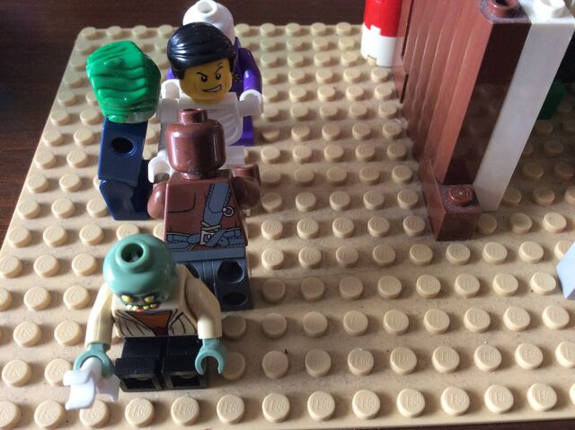 File:Killed man with LEGO zombies.jpg
