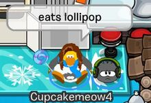 A tomboy pookie eating a lollipop