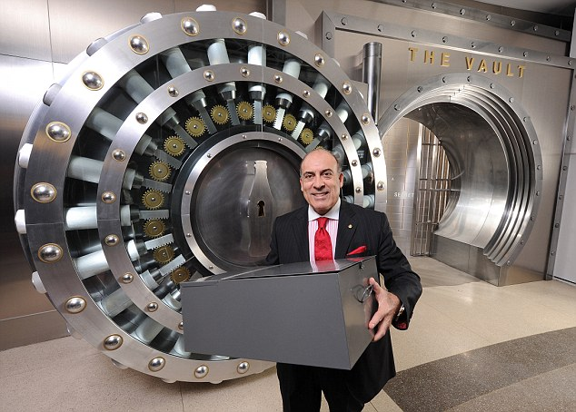 File:Muhtar-Kent-Coca-Cola-Company-CEO-is-placing-a-metal-box-which-the-company-says-contains-the-formula-inside-a-five-foot-high-safe-.jpg
