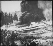 French soldiers making a gas and flame attack on German trenches in Flanders. Belgium., ca. 1900 - 1982 - NARA - 530722.tif