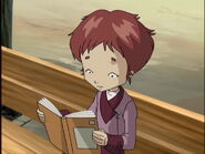 Taelia leyendo un libro