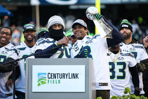 Russell Wilson, Marshawn Lynch with Lombardi Trophy