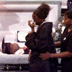 Shoels in his casket