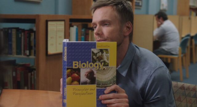 S03E22-Jeff w Biology textbook