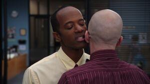 S02E04-Spreck whispering in Pelton's ear