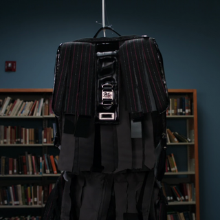 Abed has Annie's backpack taken out.