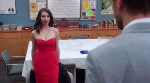 Evil Annie in a red dress