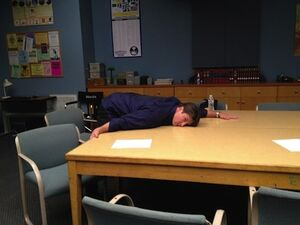 Nathan hugs study table