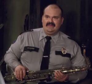 S03E04-Sgt Nunez with sax