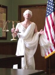 Dean Pelton as Blind Justice