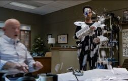 5X7 Abed sprays Hickey's desk