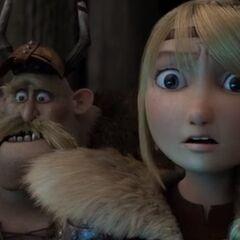 Astrid junto a Bocon sorprendidos por una luz que viene desde el hielo