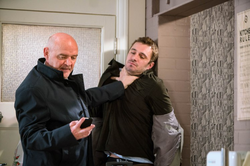 Phelan threatens Andy Carver