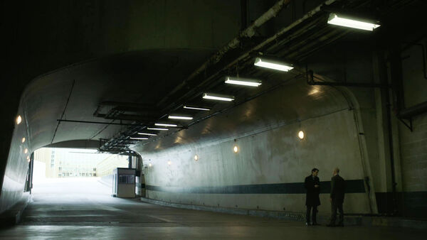 Peter-Quayle-with-Howard-in-OI-Tunnel-Counterpart-STARZ-Season-2-Episode-01-inside-out