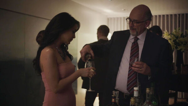 Nazanin-Boniadi-Richard-Schiff-Clare-and-Roland-Fancher-at-Peter's-party-Counterpart-Season-1-Episode-7-The-Sincerest-Form-of-Flattery