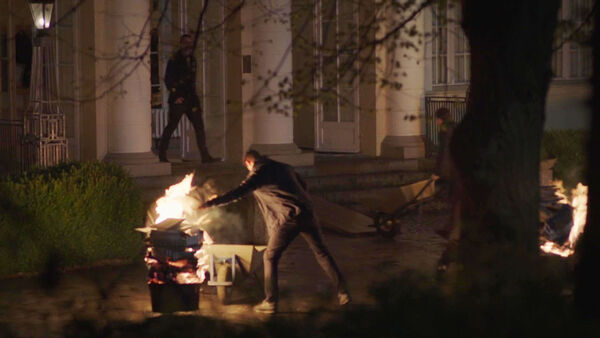 Agents-burn-documents-at-Potsdam-house-Counterpart-STARZ-Season-1-Episode-6-Act-Like-Youve-Been-Here-Before