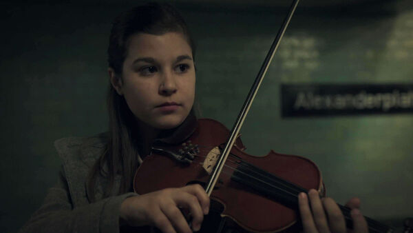 Alessandra-Reggiani-as-Young-Nadia-plays-in-Alexanderplatz-station-Counterpart-STARZ-Season-1-Episode-2-Birds-of-a-Feather