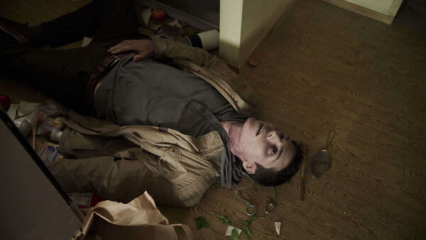 Nolan-Gerard-Funk-as-D1-Oskar-Wolfe-dead-in-his-apartment-Counterpart-STARZ-Season-1-Episode-10-No-Mans-Land