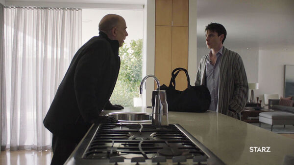 JK-Simmons-Harry-Lloyd-D2-Howard-and-Peter-Quayle-in-Quayles-kitchen--Counterpart-STARZ-Season-1-Episode-9-No-Mans-Land