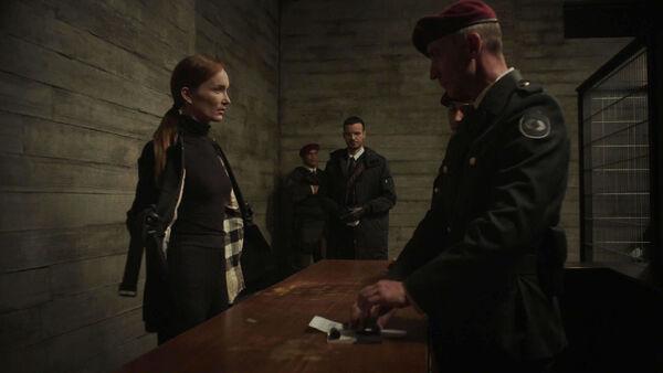 Lottee-Verbeek-and-Junes-Zahdi-goe-through-customs-Sleepers-Counterpart-STARZ-Season-1-Episode-5-Shaking-the-Tree